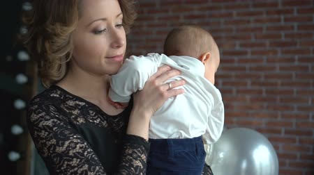 months : mother holding her baby son in her arms. family concept Stock Footage