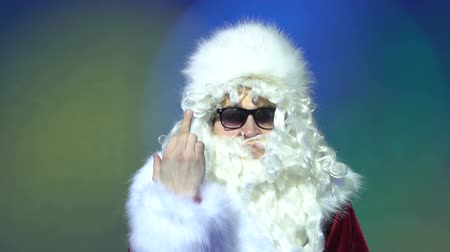 transação : Middle finger, upset Santa Claus shows aggression on party, indoor. Stock Footage