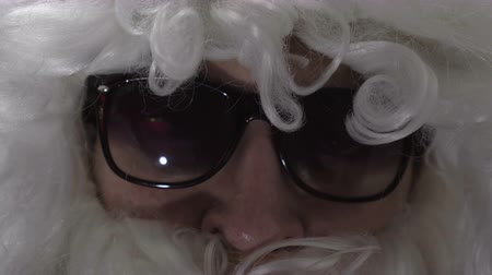 bilge : close-up of an elderly man. Face of actor in santa suit