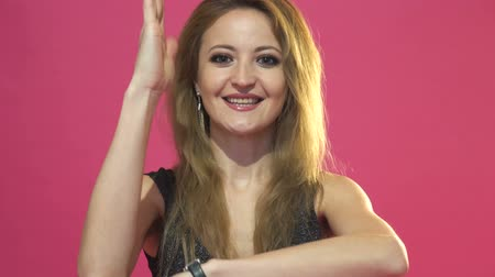 know : Happy woman raising hand knowing the answer to the question on pink background Stock Footage