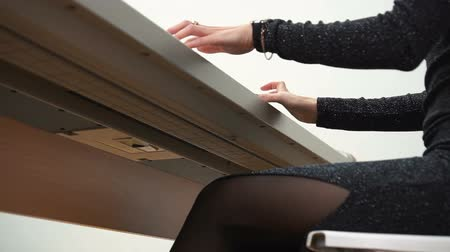 piano parts : Low angle of woman playing synth