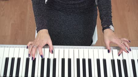 piano parts : Female Pianist Hands Playing Piano Top View