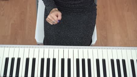piano parts : Top view of female pianist hands playing piano use one hand