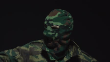 герои : Closeup portrait of happy young soldier in camouflage and military mask. Positive, success emotion
