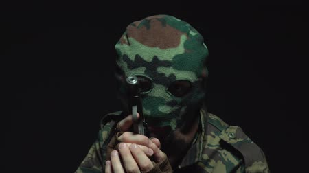 without face : Soldier in camouflage and military mask with a gun