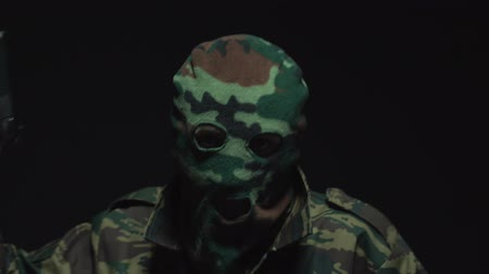 balaclava : Soldier in camouflage with a gun Stock Footage