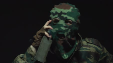 without face : Soldier in camouflage talking on the phone Stock Footage