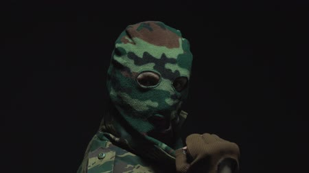 without face : Closeup portrait of happy young soldier in camouflage and military mask. Positive, success emotion
