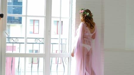 negligee : backstage with photo shoot for a young pregnant woman Stock Footage