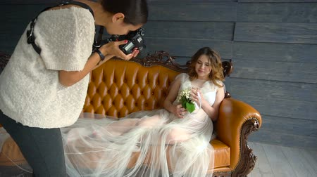 подвенечное платье : backstage photographing of a young beautiful pregnant girl with wreath