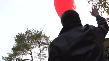 see off : Man waves his hand to hot air balloon. Welcomes passengers
