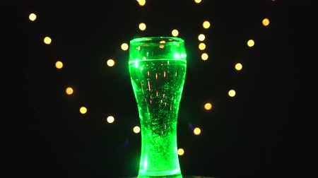 cold drinks : Glass of water in light green light is spinning. Green cocktail. Bar concept Stock Footage