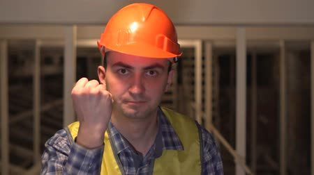 ameaça : Enraged nervous worker or an engineer is threatens someone with his fist and is making an admonition