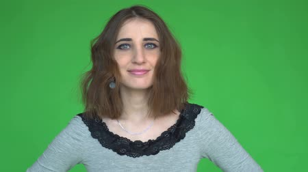 aprovado : Young happy woman says Yes, by shaking her head. posing against a removable chroma key background.