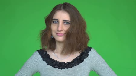 rejeitar : Young woman says No, by shaking her head. posing against a removable chroma key background.
