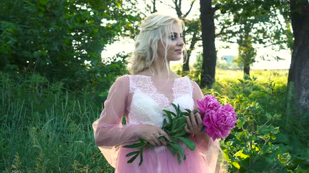 magenta flowers : Beautiful bride outdoors in a forest