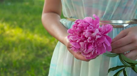 magenta flowers : The big lilac flower in beautiful female hands