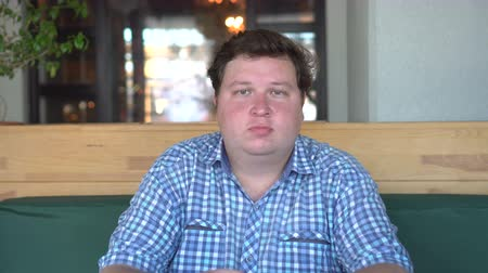 otuzlu yıllar : Portrait of white Caucasian hungry sad big fat stout man looking directly in camera in cafe.