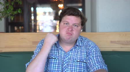 pugni chiusi : portrait of angry fat man shaking his fist in cafe or restaurant