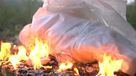 white cloths : Burning white cloth or dress on ground