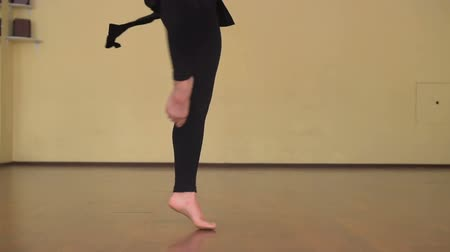taniec towarzyski : Close up of female contemporary dancer legs choreography making pirouettes in slow motion