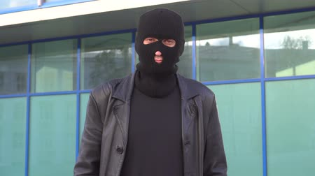 villain : Man in the mask standing outdoor. Robber, bully, hoodlum, thug, ruffian Stock Footage