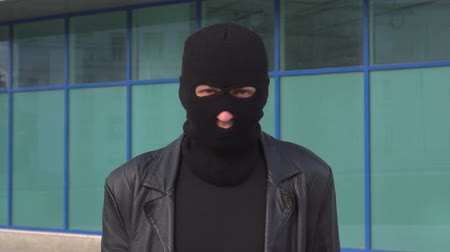 villain : Criminal man thief or robber in mask says No, by shaking his head. Portrait of man in balaclava