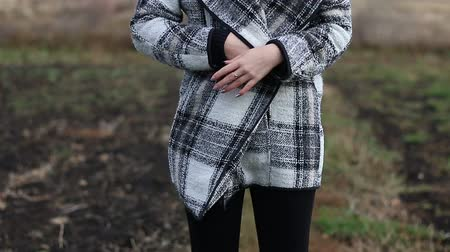 without face : Unrecognizable girl in a plaid coat outdoor