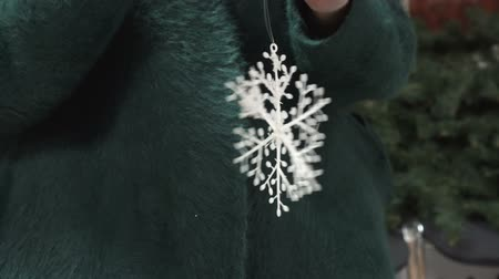 降誕 : Womens hands holding a Christmas toy - snowflake.