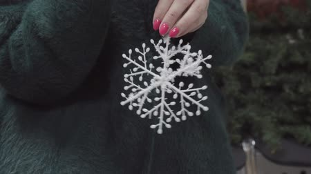 women's : Womens hands holding a Christmas toy - snowflake.