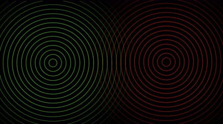 Abstract red and green circles beating on black background