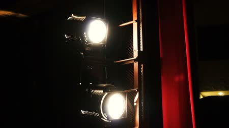 from behind : Vintage theater spot light on red curtain