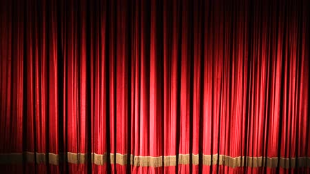samet : Red closed curtain with light spots in a theater or opera
