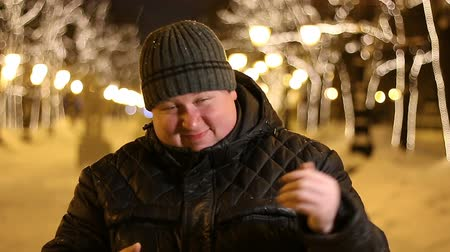 aliciamento : Portrait of happy man inviting outdoors during cold winter evening