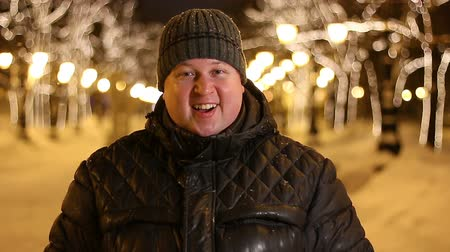 delighted : Portrait of satisfied surprised handsome man celebrating outdoors during cold winter night
