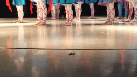 entusiasmo : Closeup of female legs of dancers moving on dancing floor of stage. Stock Footage