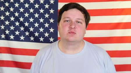 front national : Portrait of fat man in front of the American Flag