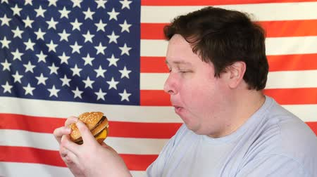 plezant : Diet failure of fat man eating fast food hamberger. American national food