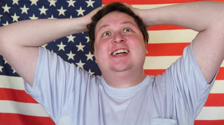 delighted : Happy American supporter man presentation cheerful sport fan