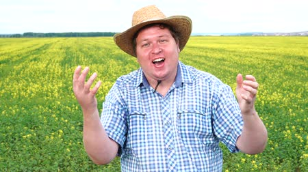 overweight : Winner! A dream of the young fat farmer came true. He is very excited, wearing hat, celebrating