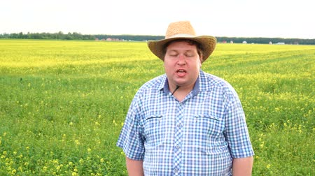 hat : Farmer standing in field and talking about something, wear cowboy hat on a sunny day