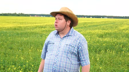 looking far away : Portrait of Male Farmer Standing on Fertile Agricultural Farmland Soil, Looking into Distance