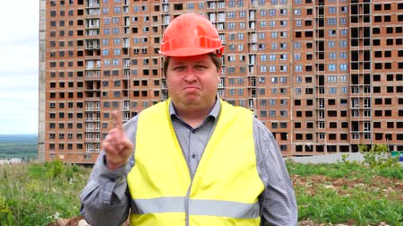 realty : Male builder foreman, worker or architect on construction building site does not agree waving his finger. Stock Footage