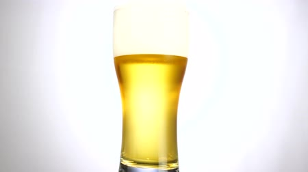 waterdrop : Glass of beer turns slowly around its axis