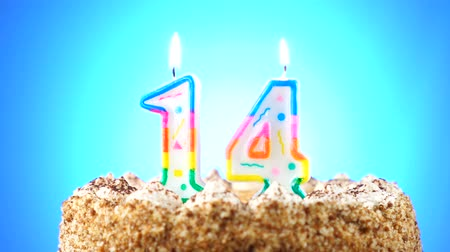 gênero alimentício : Birthday cake with a burning birthday candle. Number 14. Background changes color Stock Footage