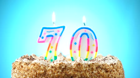 doğum günü : Birthday cake with a burning birthday candle. Number 70. Background changes color