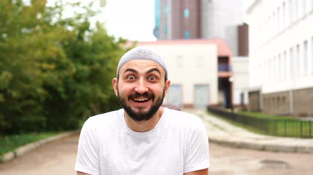 восхищенный : Handsome happy bearded muslim man in city with surprised emotion. Amazing, shocked emotion by young guy Стоковые видеозаписи