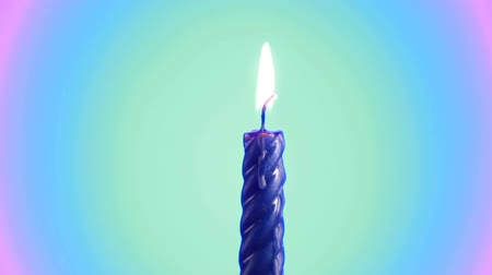 запомнить : Burning and rotating blue candle with burning flame Стоковые видеозаписи