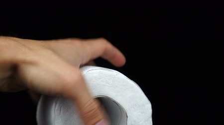 toeletta : Man holding a roll of white toilet paper in his hand