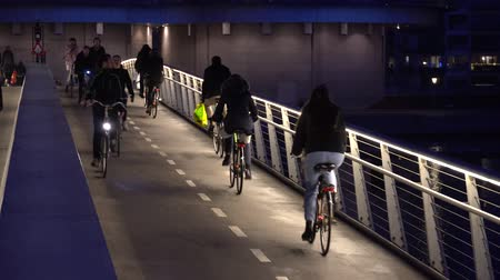 February 18, 2019. Denmark, Copenhagen. The pedestrian bridge is divided into two parts: a bicycle road and a hiking path. City night view with highlight. Ecological view of transport bike in Europe.